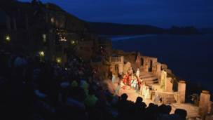 Actors performing at an open-air theatre in Cornwall