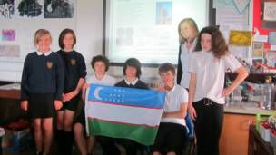 Pupils prepare to welcome the Uzbek Olympic squad