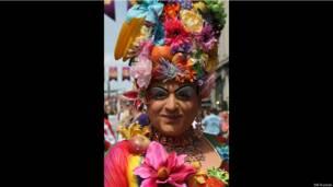 Участница гей-парада.