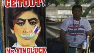 Poster Yingluck Shinawatra. Foto: Chaiwat Subprasom/Reuters