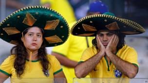 حزن الجمهور البرازيلي بملعب مينيراو بمدينة بيلو هوريزونتي البرازيلية في 8 يوليو/تموز 2014 - اسوشيتد برس