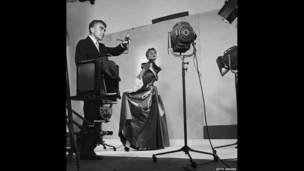 Horst directing fashion shoot with Lisa Fonssagrives, 1949. Getty Images