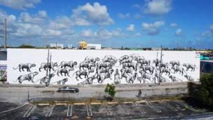 Mural del grafitero argentino JAZ, se ven toros