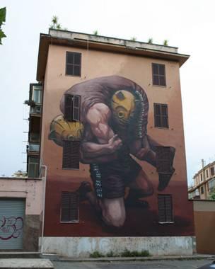 Mural del grafitero argentino JAZ, se ven hombres luchando