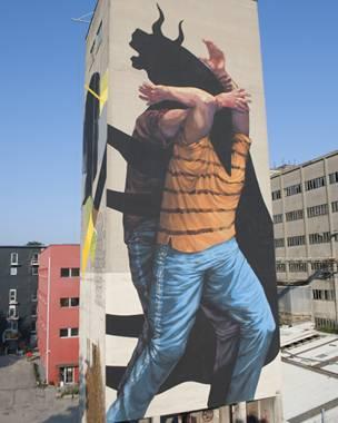 Mural del grafitero argentino JAZ, se ve hombre concabeza toro