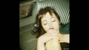 Woman drinking by Todd Hido