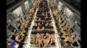Soldiers serving with 16 Air Assault Brigade seated on a Royal Air Force C17 for the final leg of their journey to Afghanistan
