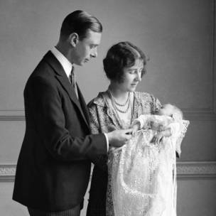 The Queen Mother (then the Duchess of York) with her husband, King George VI (then the Duke of York), and their daughter Princess Elizabeth at her christening
