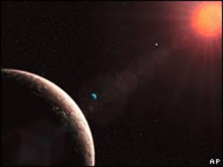 Planeta Gliese 581 E (à esq.)
