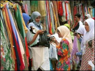 Mulheres na Malásia. Foto:AP/Teh Eng Koon