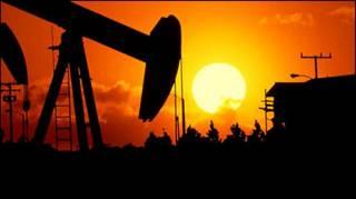 تصویر چاه نفت در غروب آفتاب