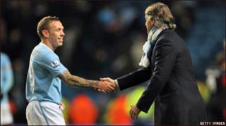 Mancini shakes hand with Bellamy after the win 2-0 over Stoke