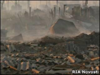 Пепелище сгоревшего дома