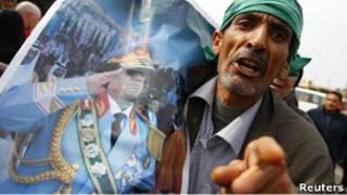 Участник выступления в поддержку Каддафи