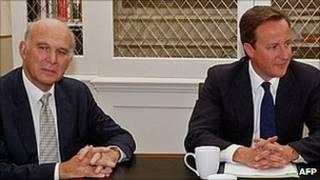 Ông Cable (trái) và Thủ tướng Cameron