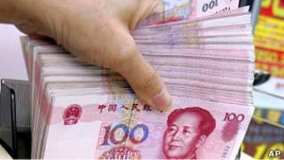 Курс юаня вызывает разногласия