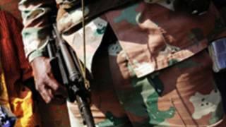 Un homme armé en République démocratique du Congo