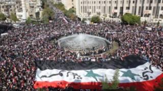 Mudaaharaad lagu taageerayo madaxweyne Assad