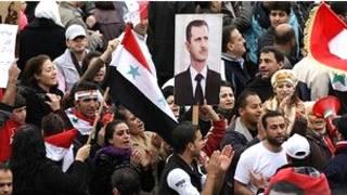 सीरिया में प्रदर्शनकारी