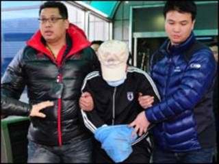 Chinese captain taken away by S Korean officers