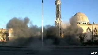 Umwotsi uracumba nyuma y'igisasu mu mujyi wa Homs