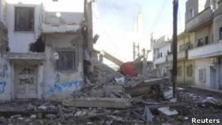 جانب من القصف الذي تعرضت له حمص
