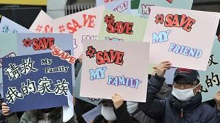 Người biểu tình chống chính sách hồi hương người tị nạn Bắc Hàn của TQ ở Bắc Kinh