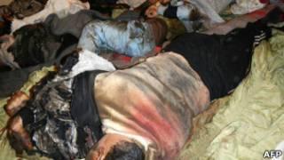Corpos em Homs (AFP)