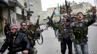 Rebeldes sírios em Idlib, em foto de 11 de março (AP)