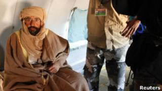 سيف الاسلام، پسر معمر قذافی در بازداشت بسر می برد