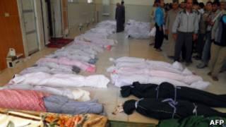 Corpos de vítimas de ataque em Houla (AFP/Getty Images)