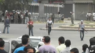 Milicianos da shabiha durante ação em Damasco. Foto: AP