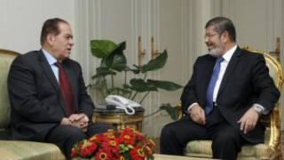 مرسي والجنزوري