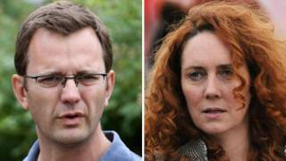 Andy Coulson (L) and Rebekkah Brooks