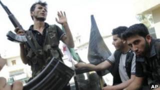 Повстанцы, которые участвуют в боях с правительственными войсками в Сирии