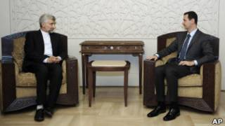 Saeed Jalili e Bashar al-Assad em encontro em Damasco (Foto: AP)
