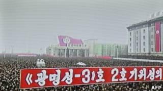 Участники шествия в Пхеньяне