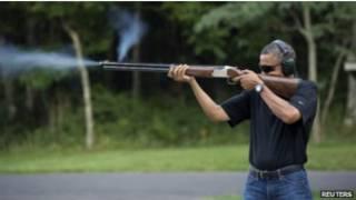 Барак Обама с ружьем