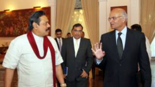 presidient mahinda rajapaksha with advisior menon