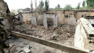 Дом, уничтоженный в результате насилия в Кашгаре