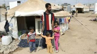 Sírios em campo de refugiados no Iraque