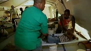 Жертва холеры на Гаити