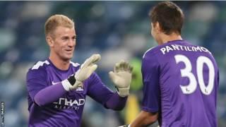 哈特(左)和二号守门员潘蒂利蒙