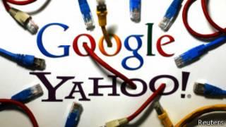 Лого компаний Google и Yahoo с переплетенными кабелями