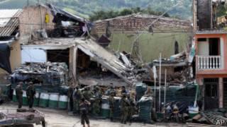 Последствия подрыва полицейского участка в Колумбии