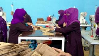 afghani women in a flip-flop factory