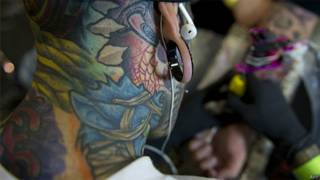 Tatuador (Arquivo/AFP-Getty)