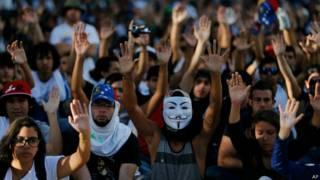 manifestantes em Caracas   AP
