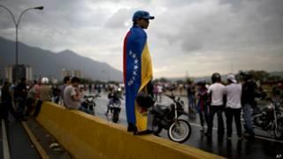 Manifestantes de opsición en Venezuela