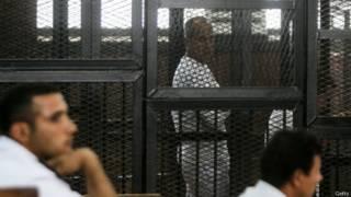 صحفي قناة الجزيرة، بيتر جريستي في القفص